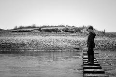 Three Cliffs Bay, South Wales (David Claringbold) Tags: boy white black water wales river bay three sand nikon rocks raw child stones dunes south innocent cliffs stepping d750 tamron lightroom 2470