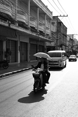 Nong Khai (g e r a r d v o n k ) Tags: street city travel people urban reflection art architecture backlight umbrella canon asian thailand eos fantastic asia photos outdoor expression ngc transport thai vehicle unlimited stad uit yabbadabbadoo asia flickraward newacademy earthasia totallythailand  pinnaclephotography artcityart