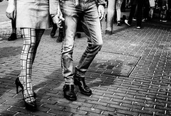 Stepping out in style. (Mister G.C.) Tags: street people urban blackandwhite bw woman man male guy feet stockings monochrome fashion lady female deutschland design europe pattern legs boots candid streetphotography jeans 20mm unposed schwarzweiss denims niedersachsen lowersaxony pancakelens primelens sonyalpha mirrorless zonefocusing strassenfotografie manualfocusing sel20f28 sonya6000