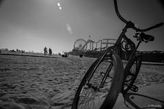 Will you whisper in my hands and let me dance inside your chest (.KiLTRo.) Tags: california blackandwhite blancoynegro beach bike wheel pier blackwhite sand unitedstates outdoor santamonica kiltro