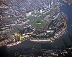 Aerial view of the North Sands shipyard (Tyne & Wear Archives & Museums) Tags: road roof shadow chimney abstract industry window glass grass sunshine metal wall buildings river daylight interesting construction iron ship crane aerialview bank rail vessel row structure riverwear cranes deck transportation frame land vehicle production unusual mast launch shipyard striking development impressive repairs vessels fascinating digitalimage sunderland 1860 facilities shipbuilding aerialphotograph industrialheritage 1846 belic bartrams fittingout shipbuildingheritage maritimeheritage northsands sd14 manorquay colourphotograph november1975 merseybridge stpeterschurchmonkwearmouth northsandsshipyard robertthompsonsons northsandssunderland 25october1975 josephlowesthompson robertthompsonsenior josephlthompsonsons debtfordyard 4september1975 palmershillquay nikitasroussos