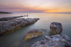 smoky skies (SamCreek) Tags: sunset sea seascape clouds landscape rocks natural pastel sony darwin alpha a7 cloudporn dryseason nightcliff a7ii wetseason sonya7 cloudsstormssunsetssunrises