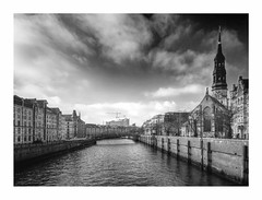Monochrome Hamburg (kurtwolf303) Tags: city sky bw church topf25 water clouds germany deutschland topf50 topf75 wasser cityscape 500v20f hamburg dramatic kirche himmel wolken stadt sw hh fleet topf150 topf100 speicherstadt 800views omd digitalphotography cityview kirchturm 2000views schwarzweis 3000views 900views 2500views elbphilharmonie worldcitycenters 4000views 750views 1500v60f 1000v40f 250v10f monochromefineart lovelycity systemcamera flickrelite artinbw unlimitedphotos micro43 microfourthirds blackwhitepassionaward olympusem5 kurtwolf303