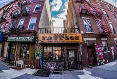Tattoos (JMS2) Tags: street bronx sony fisheye shops storefronts streetscape southbronx sobro