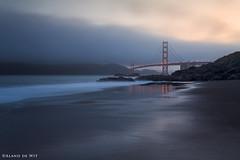 Golden Gate Reflection (aland67) Tags: california longexposure bridge blue sea usa mountain seascape beach water clouds sunrise landscape lights golden gate san tide wave hour incomingtide runningwater atlanticocean fransisco goldenhour refelections leendsoft09 alanddewit