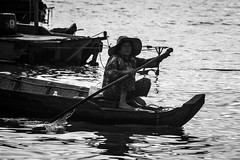 Sunset on Tonle Sap - Cambodia (virtualwayfarer) Tags: travel sunset people blackandwhite lake tourism water canon asian boats temple boat wooden asia cambodia southeastasia cambodian khmer locals dusk exploring streetphotography canoe explore local fullframe dslr siemreap merchants mythology oldwomen sunsetting tonlesap indochina blackandwhitephotography siamreap 6d inlandsea travelphotography boattour floatingcity woodencanoe solotravel independenttravel khmerempire alexberger virtualwayfarer cambodianlake floatingmerchants