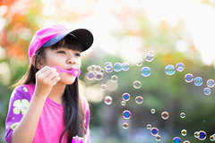 Blowing soap bubbles (Patrick Foto ;)) Tags: park summer portrait people cute green nature girl beautiful beauty childhood closeup female asian fun outdoors happy person one freedom kid spring soap healthy funny picnic pretty child play bright little background joy young meadow lifestyle happiness blowing blow human thai bubble leisure positive concept playful