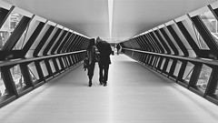 Urban Kiss (RosLol) Tags: street uk blackandwhite bw london love lines architecture kiss couple candid tunnel canarywharf londra amore architettura bacio biancoenero coppia linee onecanadasquare roslol