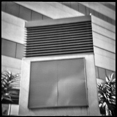 Corporate (robert schneider (rolopix)) Tags: ca sky blackandwhite bw building 120 film rooftop monochrome sign mediumformat reflections corporate losangeles 4x4 geometry patterns toycamera calif blank lucky clone expired plasticcamera urbanlandscape outdated outofdate shd100 diana151 120620 robertschneider autaut hiflash bwfp believeinfilm rolopix