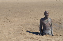 Anthony Gormley 6 (garlick.rachel) Tags: sea sky sculpture beach nature water statue clouds standing naked landscape flow coast iron looking place jetty tide horizon natur castiron anthony puddles southport gormley crosby ebb installations anotherplace