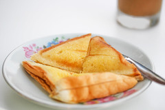 Breakfast.Toasts with butter. (diary of moon) Tags: morning food white glass breakfast bread table milk napkin toast gray knife tasty plate dry fabric butter cracker easy transparent piece chunk saucer creamy roasted tableware appetizing