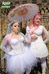 IMG_9307 (Neil Keogh Photography) Tags: pink flowers blue white green abbey graveyard yellow dreadlocks female umbrella fence shoes purple candy boots lace bra gothic goth goggles trainers tattoos gloves corset braids spikes gravestones tutu choker cybergoth whitbyabbey dogcollar fishnettights whitbygothweekend fishnettop april2016