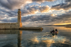 Another morning scene... (Theophilos) Tags: morning sea sky lighthouse reflection clouds sunrise boat crete rethymno