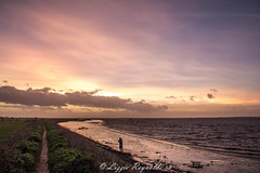 Lone figure capturing the sunset over Breydon Water, Norfolk. (lizzieisdizzy) Tags: water clouds reflections scenic calming ripples picturesque beatiful lonefigure