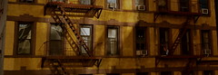 As Day Decays (MPnormaleye) Tags: city nyc windows sunset urban building stairs apartments shadows escape dusk manhattan neighborhood utata 24mm tenement
