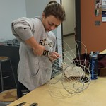 A student bending wire for an art project.