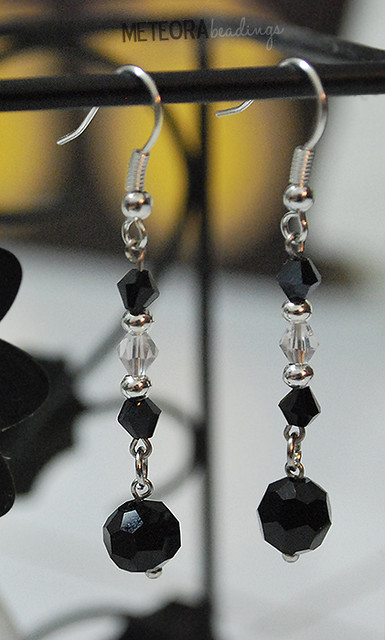 Earrings - black and clear beads, with silver seperators