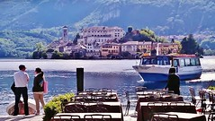Lake Orta, Italy (SM Tham) Tags: people italy lake water buildings outdoors island boat cafe chairs villages tables mountainside lakeorta italianlakes sunnyweather isolasangiulio ortasangiulio
