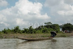 H504_3106 (bandashing) Tags: trees england sky water forest river manchester boat flood monsoon swamp land riverbank sylhet bangladesh socialdocumentary ghat aoa bandashing ratargul akhtarowaisahmed goyainnodi