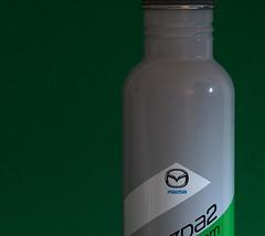 Mazda Grey (Light Collector) Tags: blue white black green advertising grey aluminum availablelight metallic mazda waterbottle theflickrlounge sundaythemecolourgrey