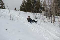 Billy sledding (Aggiewelshes) Tags: travel winter snow april billy snowshoeing wyoming jacksonhole grandtetonnationalpark 2016 gtnp taggartlaketrail