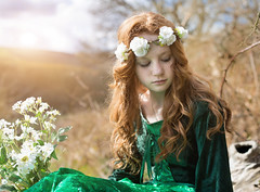 The girl with April in her eyes (windermereimages1) Tags: flowers trees red sun sunlight green girl beautiful forest hair fun evening spring log woods head marion april medievil daisys