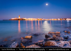 Oman - Sur - Full Moon and Al-Ayjah Lighthouse at Dusk - Blue Hour - Night - Twilight ( Lucie Debelkova / www.luciedebelkova.com) Tags: world trip travel blue light sea vacation lighthouse holiday blur building tourism beach water beautiful architecture buildings landscape asian outdoors coast asia wasser lighthouses tour exterior gulf view place muslim islam sightseeing middleeast visit location tourist east coastal journey arabia beaches vista destination sur coastline sight traveling middle visiting exploration oman landschaft touring voda gcc islamic coastlines waterscape sultanateofoman sultanate islamiccountry southwestasia arabianpeninsula luciedebelkova wwwluciedebelkovacom ashsharqiyahregion