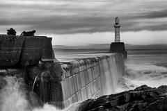 Aberdeen Harbour South Breakwater (PeskyMesky) Tags: longexposure blackandwhite bw lighthouse storm water monochrome scotland blackwhite aberdeen northsea aberdeenharbour northeastscotland southbreakwater