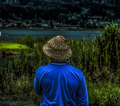 Blue (karom_12345678) Tags: blue people bali lake man hat relax temple back peace sony thinking indonisia a99