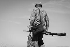 The fisherman (@Lizette Salazar Guedes) Tags: life street sky people bw fish canon uruguay photography blackwhite calle hands flickr gente dream oldman manos sueos vida sombrero fotografia viejo pescador fishman pescar canont1i