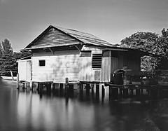 Pulau Ubin, Singapore (aquilaa1) Tags: longexposure blackandwhite house water island seaside village rustic ishootfilm woodenhouse largeformat pulauubin ilfordfp4 bwnd110 toyofield45a 10stopsndfilter r25redfilter schneiderkreuznachsymmars150mmf56 kodakhc110131dilb