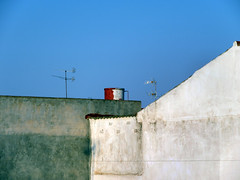 streets of cartagena (maximorgana) Tags: blue roof sky white water tank aerial antenna