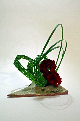 Woven lirope and dianthus in a self made vase