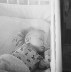 Sleeping (swedish silver) Tags: sleeping baby sunlight square infant grain delta lightleak hasselblad 3200 ilford imacon