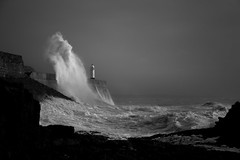 Low tide storm wave (Tim Bow Photography) Tags: light lighthouse storm nature water weather wales dark landscape pier dangerous rocks waves power impact british welsh splash swell exciting porthcawl blackandwhitephotography thrilling stormwaves porthcawlpier timboss81 timbowphotography lowtideporthcawlstorms