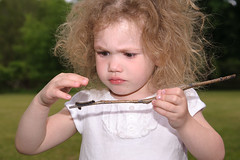 Concentrate... (Doug Hilton) Tags: child caterpillar stick concentrate wildhair
