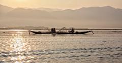 Inle Lake, Myanmar (MeriMena) Tags: travel lake beautiful canon landscape asia fishermen myanmar inle cultures canon450d merimena