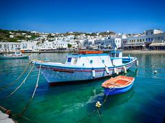 Fishing Boat in Mykonos, Greece (` Toshio ') Tags: city water windmill island greek harbor boat europe european restaurants greece shore shops fishingboat europeanunion mykonos toshio greekisland xe2 fujixe2
