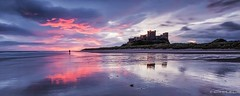 Fiery Dawn (Alun G. Davies) Tags: clouds sunrise coast northumberland bamburghcastle lonefigure