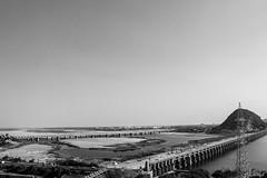 Prakasam Barrage across the Krishna river (Aditya Chandra) Tags: road bridge sky blackandwhite india mountain lake water river canal pattern krishna barrage repeat andhrapradesh vijayawada prakasam skyporn