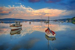 Stavento (Dimitil) Tags: sea clouds port sunrise reflections boats hellas greece cave calme milina volos thessaly magnesia valtoudi