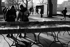 Book Stall (cycle.nut66) Tags: leica bridge light sky people blackandwhite bw london monochrome thames contrast lumix book shadows dynamic south bank stall books jour panasonic summicron waterloo tables grayscale contra lx3 againsed