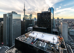 Canadian 2 (Empty Quarter) Tags: city winter sunset urban toronto ice rooftop hockey skyline cn grid downtown cityscape cntower sony canadian shangrila rink adelaide f28 core molson 14mm samyang a7r rooftopping