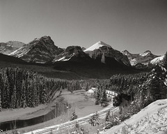 Morant's Curve (H.azteca) Tags: trees winter blackandwhite snow mountains 120 film water train river landscape rockies peaks mamiya6 banffnationalpark 75mm neopan100 tf4 ndgradfilter perceptol12 kokinp121l