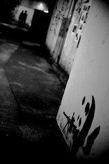 Panda sniper (a.pierre4840) Tags: blackandwhite bw monochrome hongkong graffiti nightshot olympus handheld vignetting xenon omd alleys 25mm schneider kreuznach f095 alleyways em5 cmount