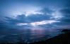 Asleep on the Horizon (Gabriel Tompkins) Tags: ocean blue sunset sky panorama usa sun seascape water backlight clouds oregon america skyscape landscape twilight nikon colorful soft pacific cloudy dusk vibrant calming lavender peaceful wideangle calm pacificnorthwest oregoncoast backlit nikkor dslr lowkey pnw 2009 cloudscape oregonstate gloaming 18105 d90 18105mm nikond90 18105mmf3556gvr tronam gabrieltompkins tronamcom