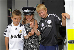 100905.135. Under Arrest. (actionsnaps) Tags: uk blackandwhite black male boys girl smiling female children happy kent serious outdoor stickers young free lifestyle samsung blond leisure familyfun handcuffs arrested arrest hairgel openday thanet broadstairs publicevent handcuffed communityevent westwoodcross totalcontrol policehat footballshirts landscapeformat margateroad horizontalimage realmadridfc kentpolice rigidhandcuffs kentfireandrescue openairentertainment foralpatterndress thanetfirestation bwimcomshirtsponsor 200809chelseaawaystrip