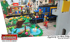 Cycling in the City (EVWEB) Tags: city danger train cycling town lego tracks rail biker diorama crossrail minifigures bricksburg