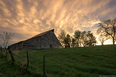 Spring Storms (Erik Johnson Photography) Tags: trees sunset summer sky orange storm green beautiful grass weather colo clouds barn golden midwest nebraska farm stock hour agriculture storms goldenhour chasing severe wx mammatus