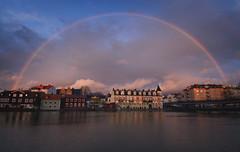 Old Town Rainbow (henriksundholm.com) Tags: bridge houses sunset sky lake clouds buildings landscape rainbow arch cloudy sweden gamlastan sverige oldtown doublerainbow hdr eskilstuna waterscape eskilstunan